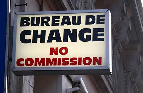 Bureau de Change sign showing no commission