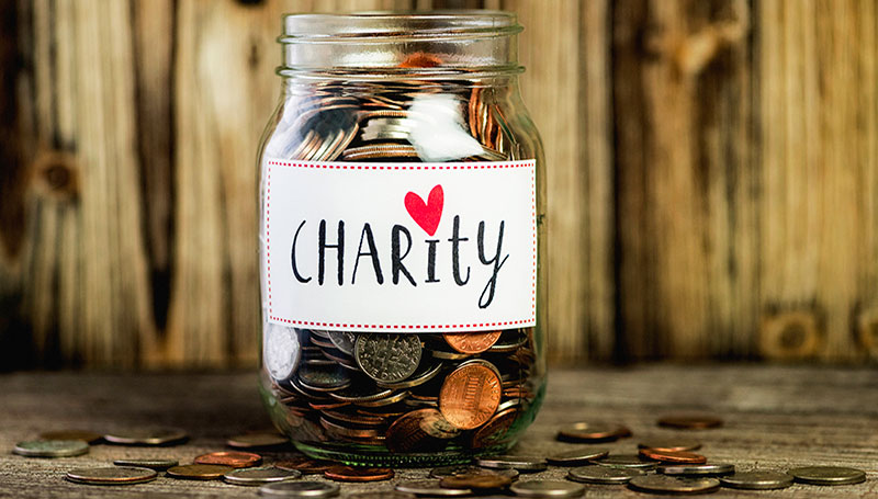 donating-leftover-currency-to-charity-feature-image