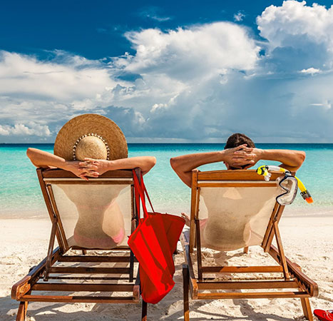 tips-for-taking-a-holiday-during-covid-19-2-people-in-deckchairs